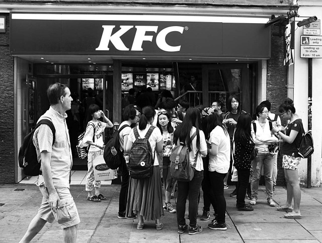 Tourists outside KFC in Oxford